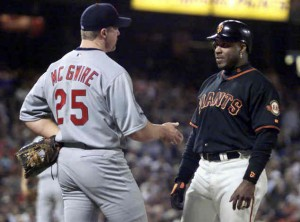 CARDINALS MCGWIRE TALKS WITH GIANTS BONDS AT FIRST BASE